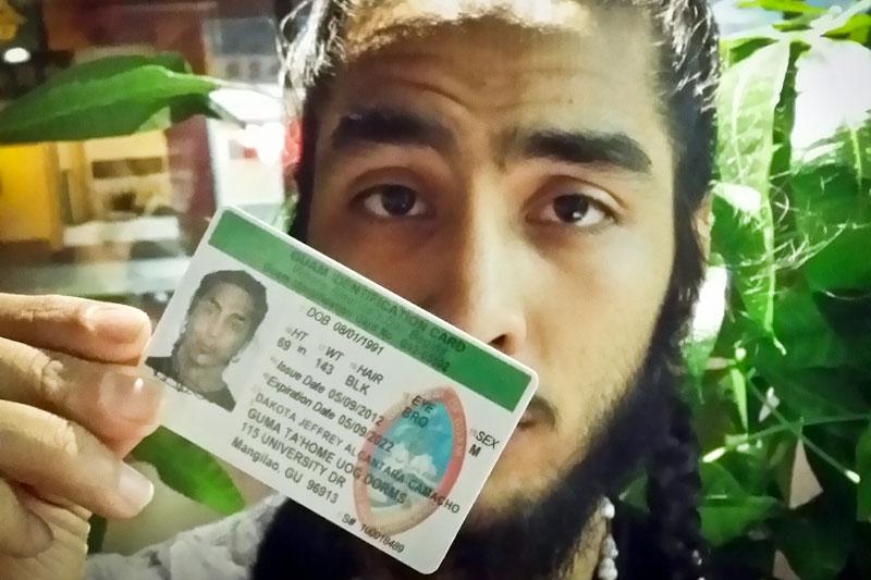 The author, with his Guam ID. (Photo by dåko'ta alcantara-camacho)