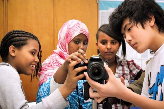 Seattle World School students Keristian, Dulamsuren, Kumneger, and Bao learn digital photography. (Photo by Sara McCaslin)