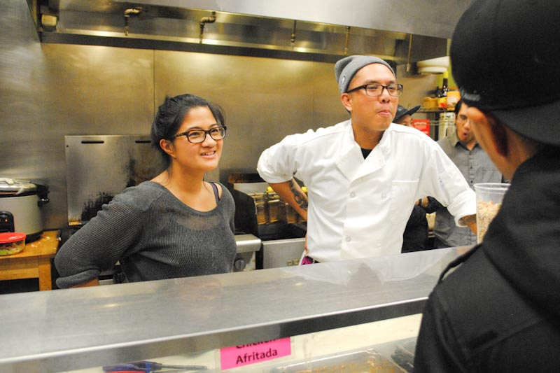 Chera Amlag and Geo Quibuyen in the kitchen at Inay's during the Pop-Up restaurant. (Photo by Anna Goren)