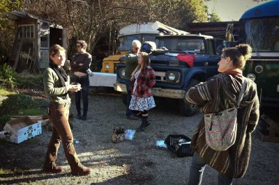 """Olympia activists, having converted a bus for the trip, are headed to Arizona to join organizers from across the nation in hopes of building alliances, finding inspiration and """"tearing down walls."""" (Photo by Sarah Stuteville)"""