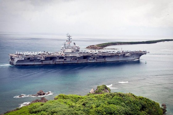 The aircraft carrier USS Ronald Reagan enters Apra Harbor in Guam. (Photo by U.S. Navy/Peter Lewis)