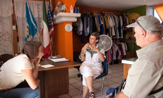Madeline McClure, Jim Marx and Sr. Judy Bourg discuss the work of the Migrant Resource Center (Photo by Bob Torrez)
