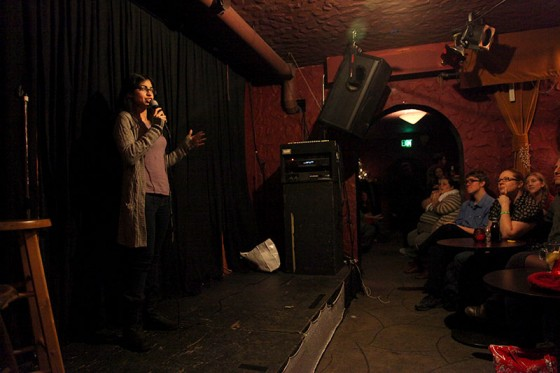 Comedian Aisha Farhoud performs at the Comedy Womb, a female centered open mic at The Rendezvous in Belltown. (Photo by Sara McCaslin)