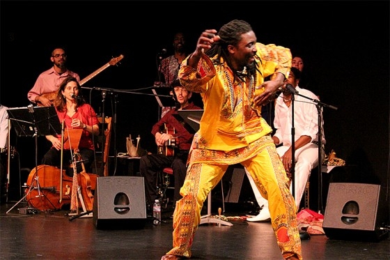 Karim Koumbassa, a Guinean performer, dances in De Cajón Project. (Photo by Aida Solomon)