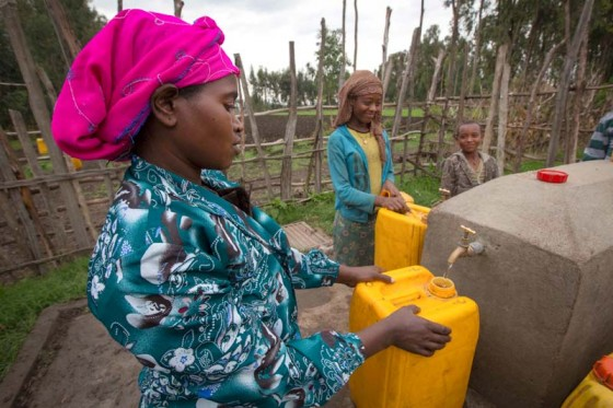 Ethiopian women fill up jugs at a water point constructed by a Seattle-based NGO. (Photo courtesy Water 1st International)