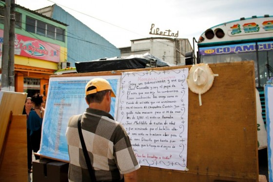 A man at the annual Encuentro de Victimas (Meeting of Victims) reads a poem written by the father of a child killed by the military in Morazán province. (Photo by Alex Montalvo)