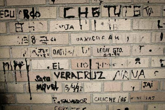 Graffiti left in the exercise yard by former detainees. (Photo by Alex Stonehill)