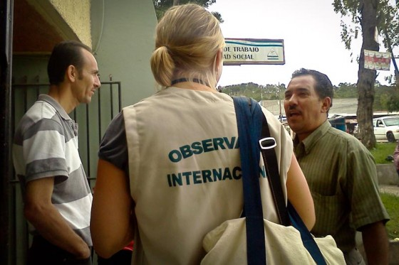 International observer Heather Wolford interviews Hondurans after they've cast their ballot. (Photo by Madeline McClure)