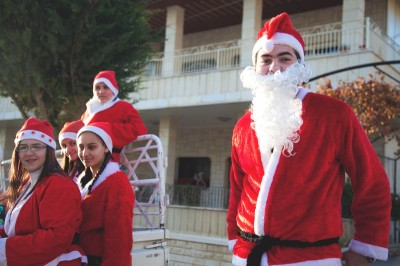 Young Santas ride around Maaloula, Syria in a pickup truck during Christmas of 2010. (Photo by Alex Stonehill)