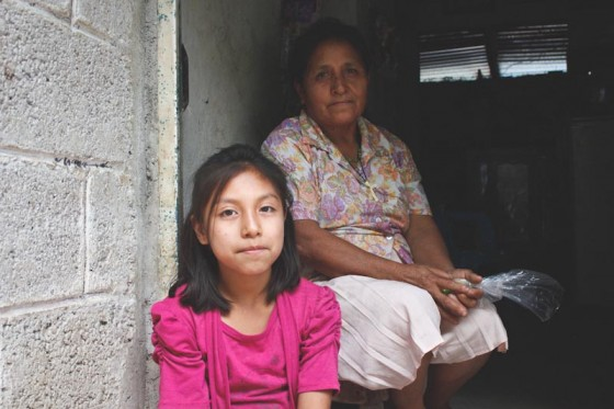Reina Martinez Olivares (right) with her granddaughter. (Photo by Liliana Caracoza)
