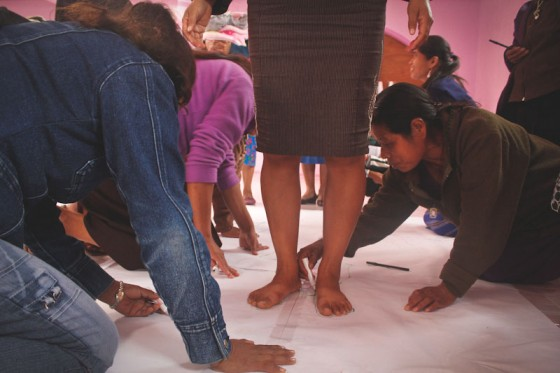 At an AX workshop, local women do exercises to learn about their individual legal and human rights. (Photo by Liliana Caracoza)