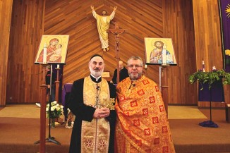 Father Abdulah Tafas (left), originally from Syria, is a priest with the Syriac Orthodox Church. Samir Abu Lail, originally from Jordan, is priest with the Melkite Catholic Church. Last Sunday both presided over services at Saint Joseph in North Seattle — a Melkite church where many Middle Eastern Christians gather. (Photo by Sara McCaslin)