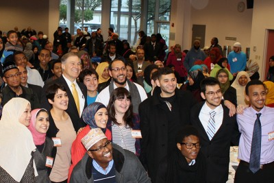 Gov. Inslee poses with advocates prior to their march and rally of hundreds. (Photo by Atia Musazay)