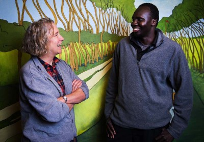 Sarah Zerkel, a parent with Lutheran Community Services' foster care for international kids program, talks with Biel Yuol, who was her and husband Tom's first foster child. (Photo by Lindsey Wasson / The Seattle Times)