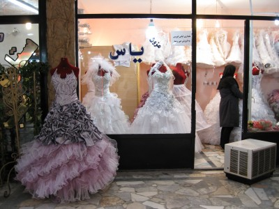 The storefront of a bridal shop and its shopkeeper in Nishapur, Iran