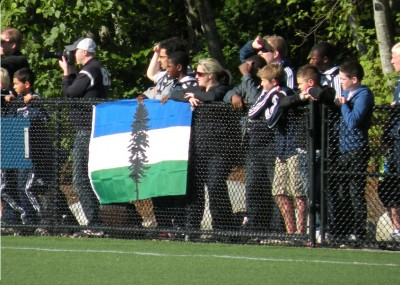 The Doug flag is seen flying at soccer games across the region, including here at a Vancouver Whitecaps game at Simon Fraser University. (Photo courtesy of BlueAndWhiteArmy, via Flickr)