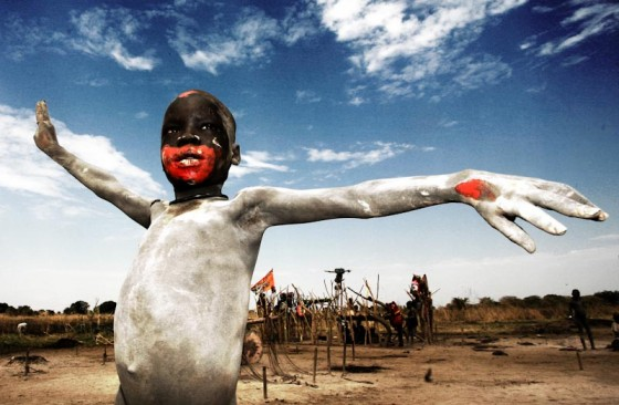 An ash covered Mundarichild celebrates the first South Sudan Independence Day in 2011. (Photo by Giovanni Turco / Freedom House DC)
