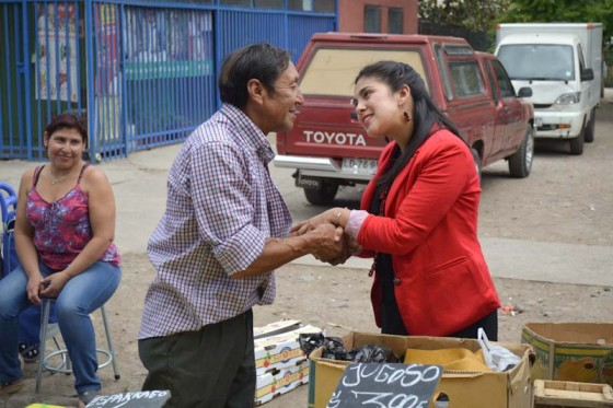 Karol Cariola, one of Chile's former student leaders and newly-elected members of Congress, meets with a constituent after the elections. (Photo by Eilís O'Neill)