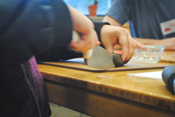Participants in PCC Cooks class, 'Winter Nights in Siberia,' chop pickles for rassolnick. (Photo by Anna Goren)