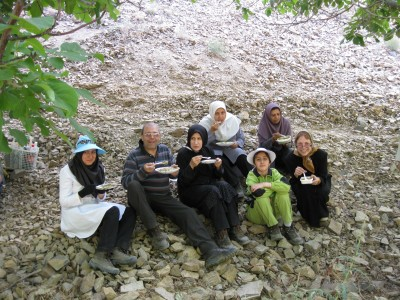Saheli-Esfahani (bottom far right) enjoying a cup of aash (soup) with a family in Nishapur, Iran. (Photo courtesy Haideh Saheli-Esfahani)