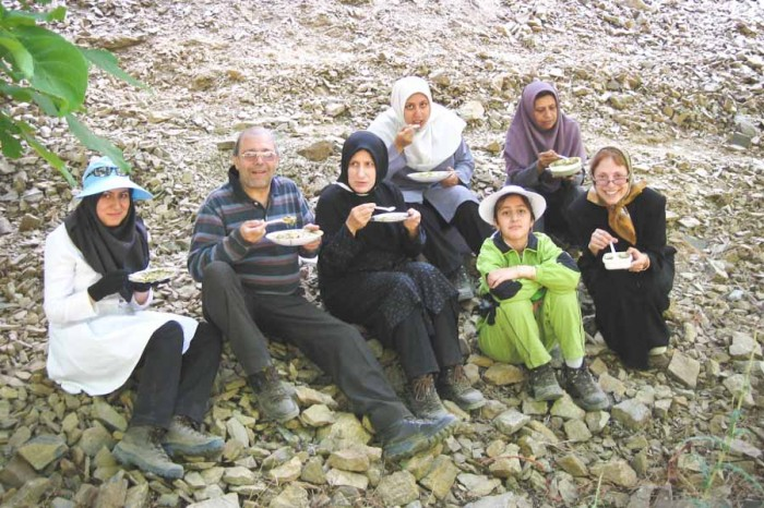 Saheli-Esfahani (bottom far right) enjoying a cup of aash (soup) with a family in Nishapur, Iran. (Photo courtesy  Haideh Saheli-Esfahani)
