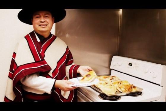 Chef Aurelio Pino presents his famous empanadas wearing traditional Chilean garb. (Photo courtesy Aurelio Pino)