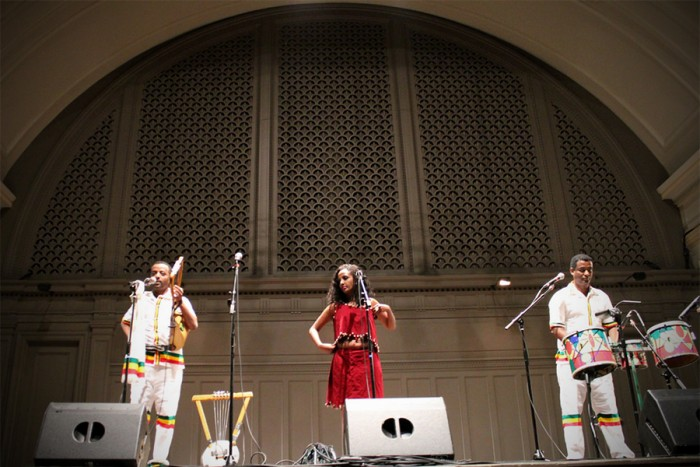 Temesegen Zeleke, Beli Nigussie and Grum Begashaw perform a song from the Ethiopian region of Oromia. (Photo by Aida Solomon)