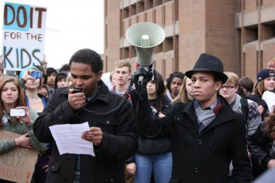 Obadiah' Terry (right) leads a student walkout in Seattle. (Photo by Hali Anne)