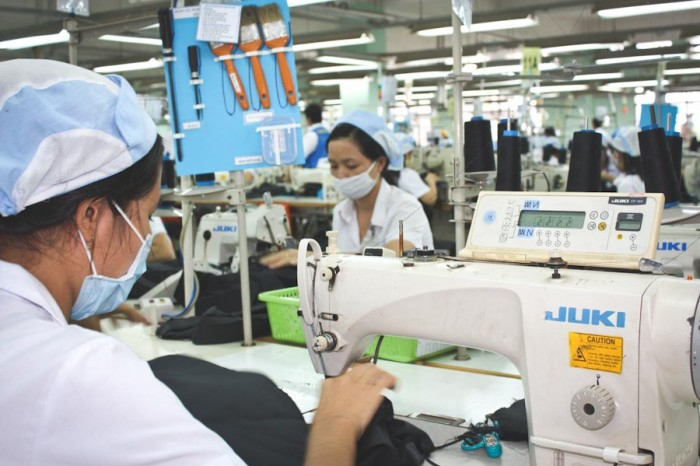 Free trade agreements eliminate domestic manufacturing jobs, while driving down wages and labor conditions in foreign factories, like this one in Vietnam. (Photo by A. Dow / ILO)