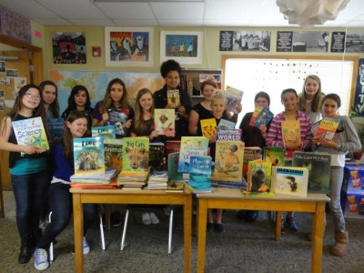 Richard's Rwanda-IMPUHWE's Seattle Grace School (SGS) chapter advisor Wendy Ewbank and her students succeed in earning 150 books to donate to Rwanda at SGS last spring. (Photo courtesy of Wendy Ewbank)