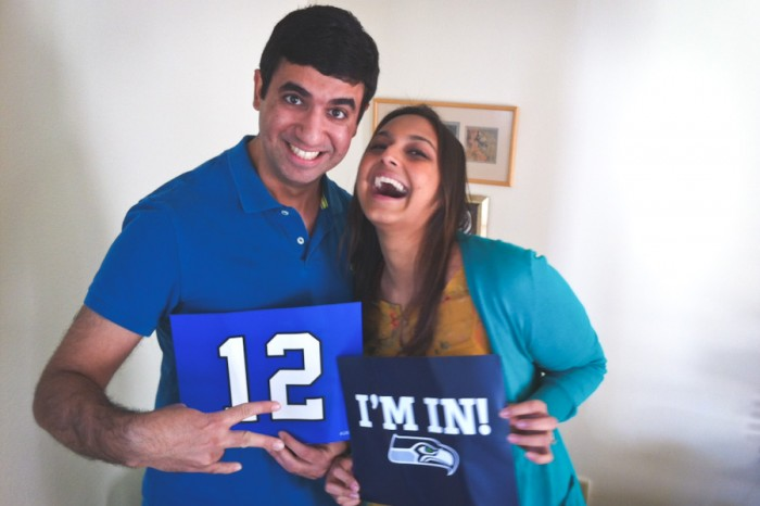 The author and her husband show off their Seahawks pride. (Photo by Alex Stonehill)