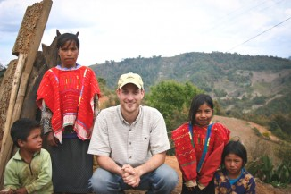 Author Seth Holmes (center) with Triqui family in the mountains of Oaxaca, Mexico.