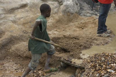 Mining operations in the Congo are often worked by children. Patrice, 15, has worked the Kaniola gold mine in South Kivu since he was eight years old. (Photo courtesy of Image Journeys Sasha Lezhnev via Flickr)