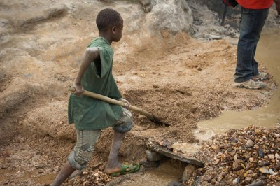 Mining operations in the Congo are often worked by children. Patrice, 15, has worked the Kaniola gold mine in South Kivu since he was eight years old. (Photo by Image Journeys Sasha Lezhnev via Flickr)