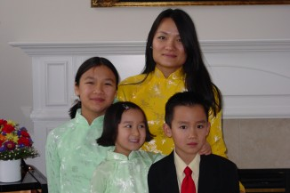 The author with his mother and two sisters in 2003. (Photo courtesy of Amanda Tran)