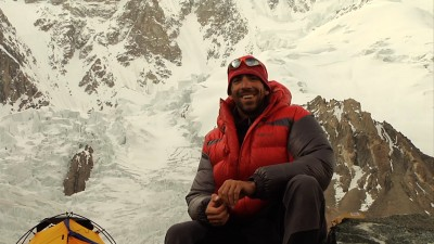 Fabrizio Zangrilli relaxes at the base camp of K2, preparing for an interview with Dave Ohlson's to be featured in his documentary K2: Siren of the Himalayas. (Photo courtesy of Dave Ohlson)
