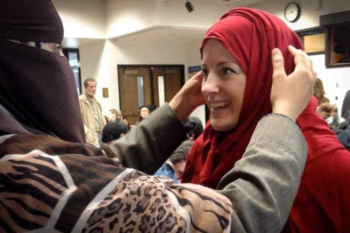 Azzah Albishi (left) and other North Seattle Community College students shared their experience of wearing a headscarf with other students and faculty at a World Muslim Day even on Monday. (Photo by Cara Romanik)