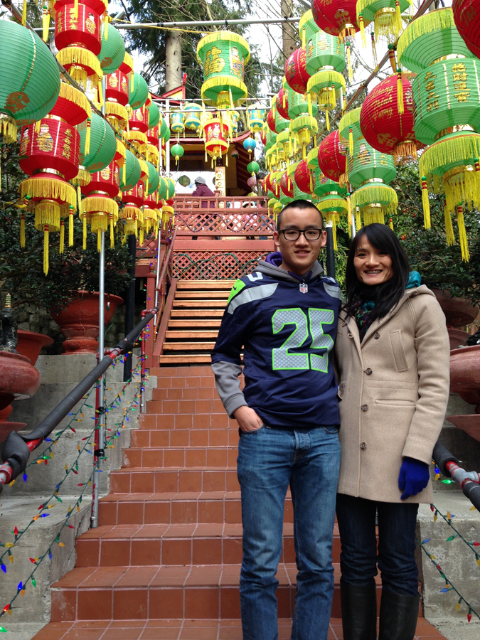 The author with his mother at Dia Tang Buddhist Temple in Lynnwood during the Lunar New Year. (Photo courtesy of Amanda Tran)