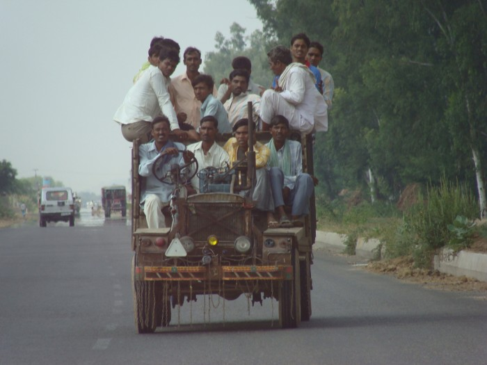 A vehicle in India is filled to the brim with carpoolers. (Photo by clara and james via Flickr)