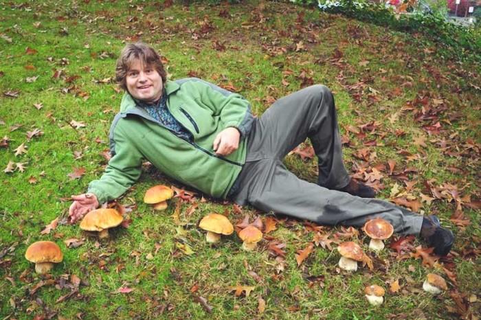Daniel Winkler in the field with some prize mushrooms. (Photo courtesy Daniel Winkler)