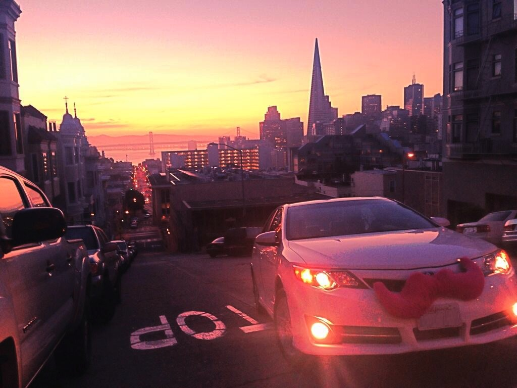 A car sports the unmistakable pink mustache of Lyft's ridesharing service. (Photo courtesy of Lyft)