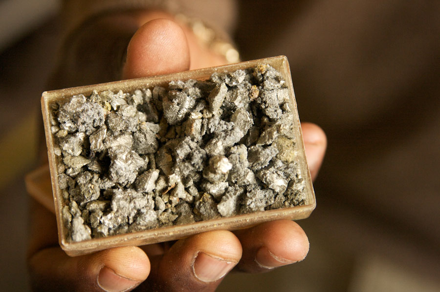 "Tin ore, along with tantalum and tungsten make up the ""3T minerals"" found in DR Congo, which are valuable for use in cell phones and computers. (Photo by of Image Journeys Sasha Lezhnev via Flickr)"