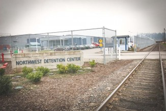 The Northwest Detention Center, a privately run facility that holds immigrants awaiting court dates and deportation. In 2010 the facility, near downtown Tacoma, was expanded to house up to 1,575 detainees. (Photo by Alex Stonehill)