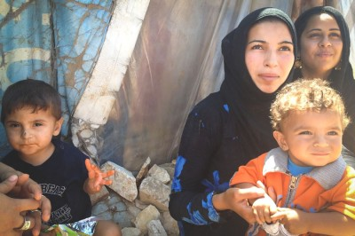 Mothers waiting for their turn at the Bekaa clinic get nutrition counseling. (Photo by Karin Huster)