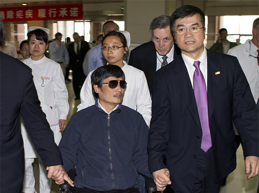 Chen Guangcheng, left, holds hands with U.S. Ambassador to China, Gary Locke, at a hospital in Beijing. Locke housed Chen at the U.S. Embassy in Beijing when he fled house arrest. (Photo from U.S. Embassy Beijing Press Office)