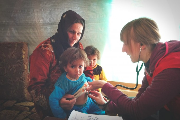 Volunteers from Humedica, a German NGO, provide medical care for young refugees in Lebanon. (Photo by Karin Huster)
