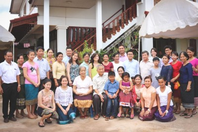 Pom Khampradith (second row, third from right) at a family reunion in Laos in summer 2013 with her siblings and extended family. (Photo courtesy Pom Khampradith)