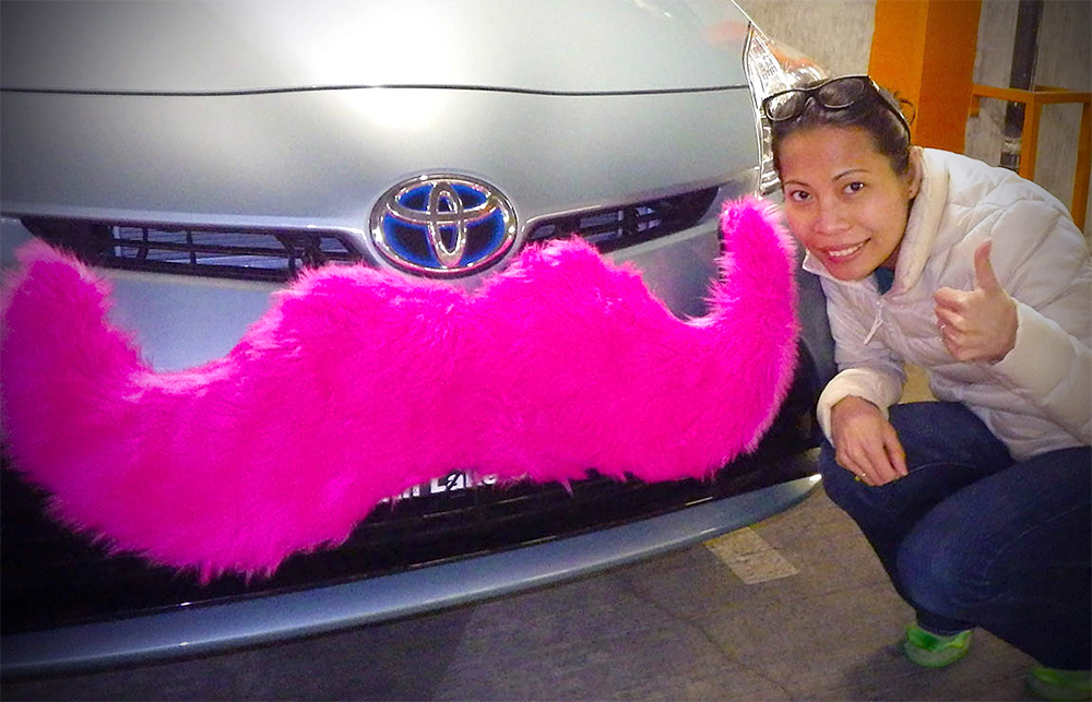 The author, Sanda Htyte, with her mustached-Lyft car. (Photo courtesy of Sanda Htyte)
