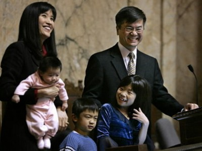 Gary Locke, near the end of his second term as Washington's governor, stands with his family during his final State of the State address on Jan. 11, 2005. To this day, Locke is the only Chinese-American official that has served as governor of a U.S. state. (Photo by Elaine Thompson)
