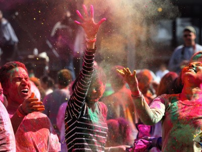 Festival goers go all out on Holi last year in downtown Redmond. (Photo by Alan Brenner)